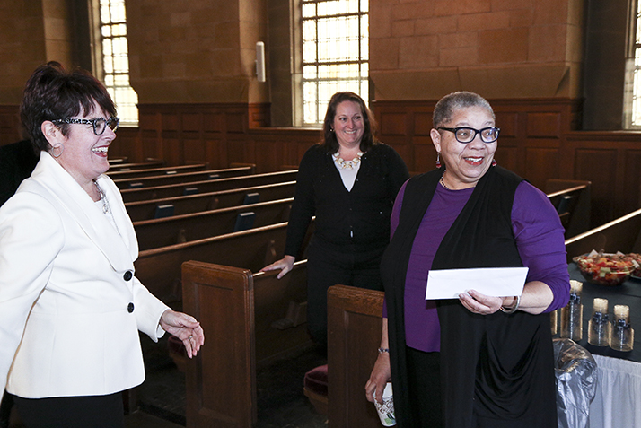 Rev. Claudia Highbaugh reacts as she learns she has won a staff award