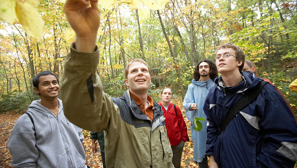 Botany professor Chad Jones with students doing fieldwork in the arboretum.