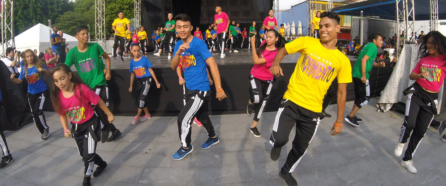 At-risk youth in El Salvador participate in a dance performance in a public park.