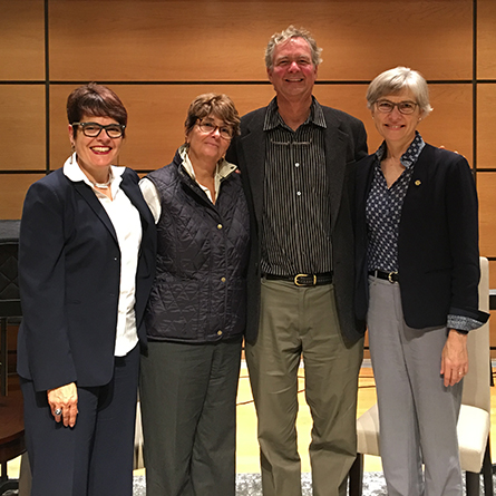 President Bergeron poses with David Haussler '75, Susan Froshauer '74 and Lynne Cooley '76