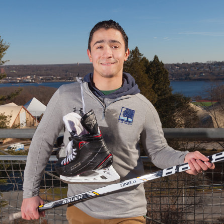 Cameron Segal '20 introduces hockey to New London's newly-arrived middle schoolers.