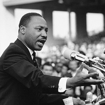 An archival photo of Dr. Martin Luther King Jr. giving a speech.