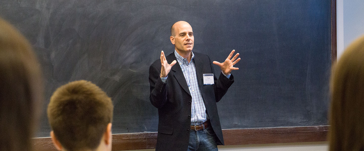 A professor talks to students during Fast Forward