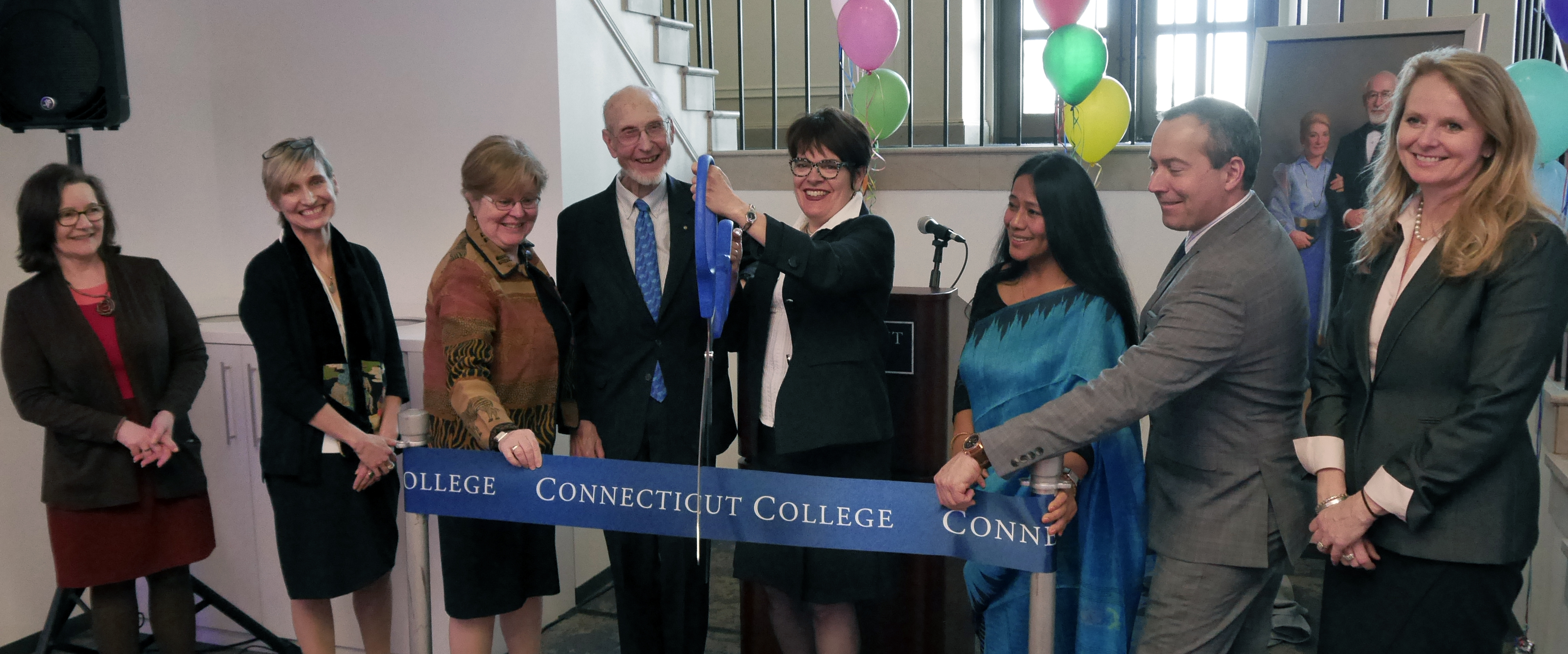 Katherine Bergeron cuts the ribbon to officially dedicate the Otto and Fran Walter Commons for Global Study and Engagement