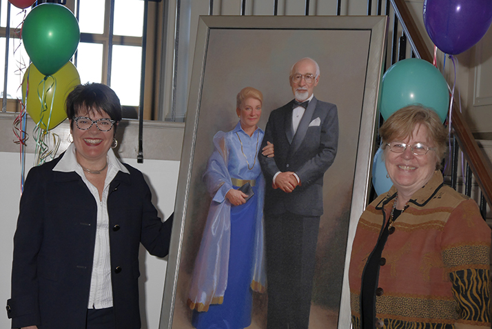 President Katherine Bergeron and Otto and Fran Walter Foundation representative Martha Peak Helman '75 pose with the official portrait of Otto and Fran Walter.