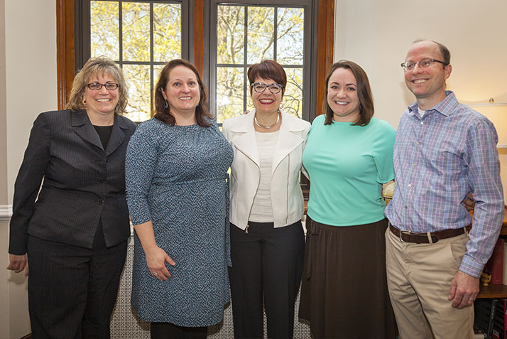 At center: President Katherine Bergeron and Makayla Grays (Rising Star Award), assistant director, institutional research and planning with John Nugent, director of institutional research and planning, and members of the President's office staff.