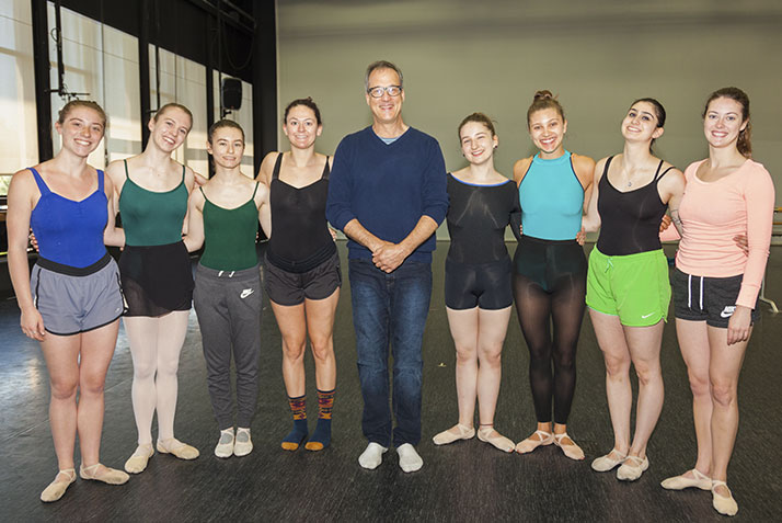 Richard Schenk (Inspiration Award), musician and composer for dance, flanked by a class of dancers.