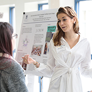 A Student Presents at the College Symposium