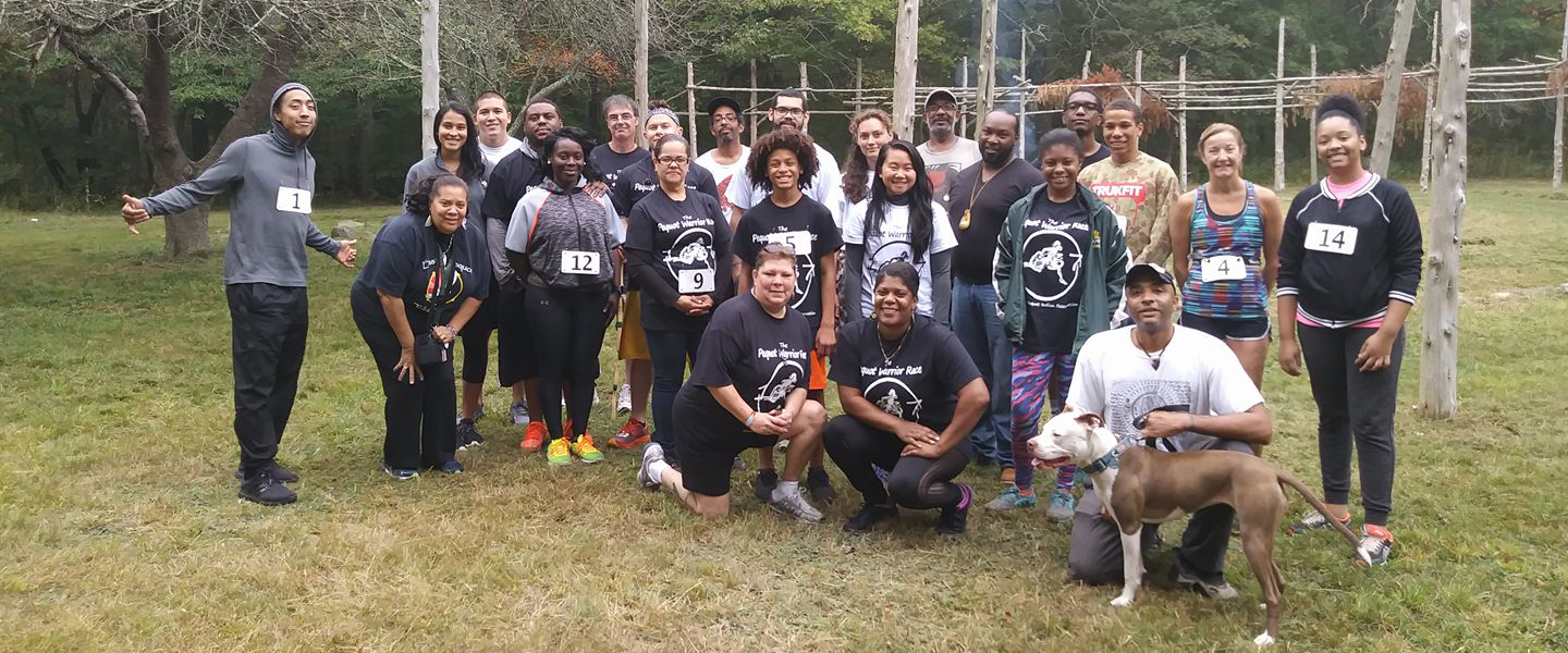 Members from the Eastern Pequot Tribal Nation, Mohegan Tribal Nation and Schaghticoke Tribal Nation pose with volunteers at the first Pequot Warrior Race in 2017 on the Eastern Pequot