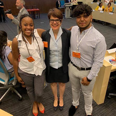 Alyss Humphrey '22 (left) and Daniel Varela '22 (Right) pose with President Katherine Bergeron at PossePlus Summit Town Hall in Westlake, Texas.