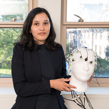 Linda He '22 with her poster at the Summer Science Poster Symposium