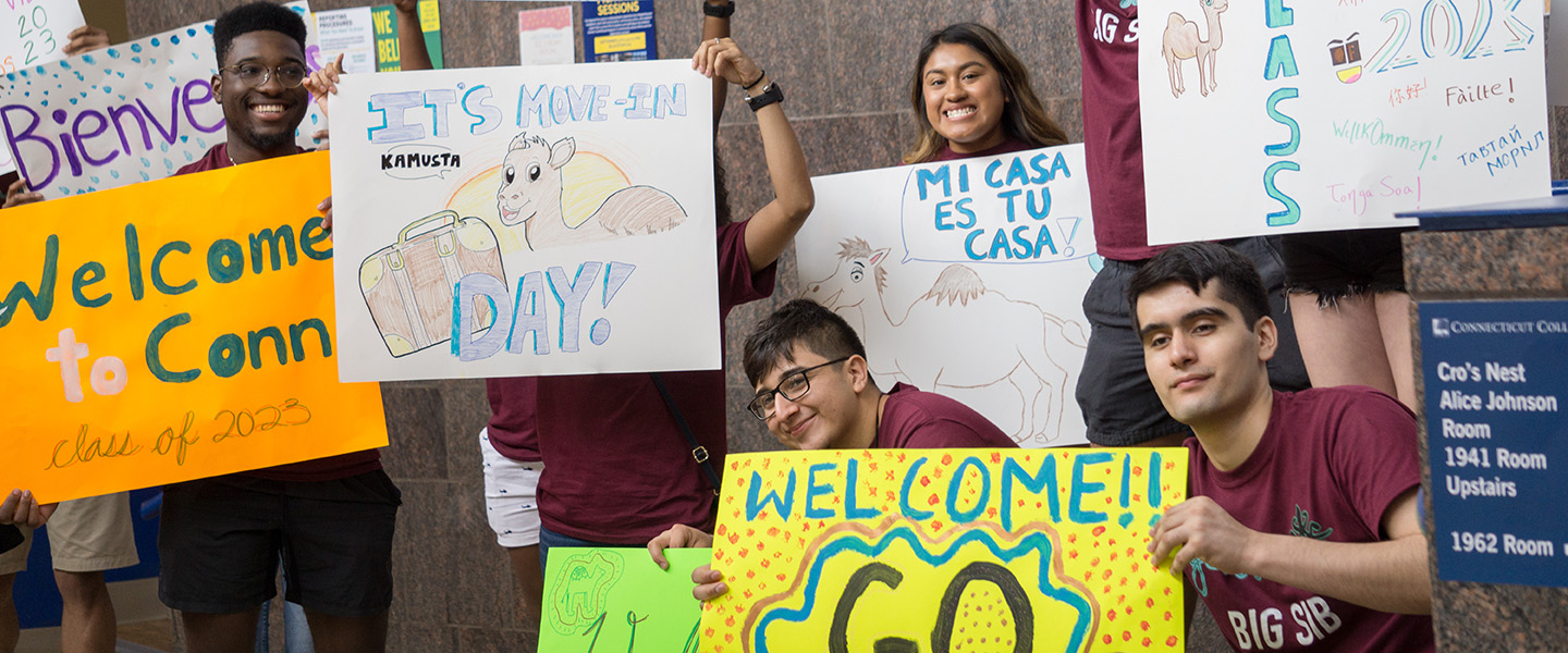 Students welcome the newest camels with colorful signs.