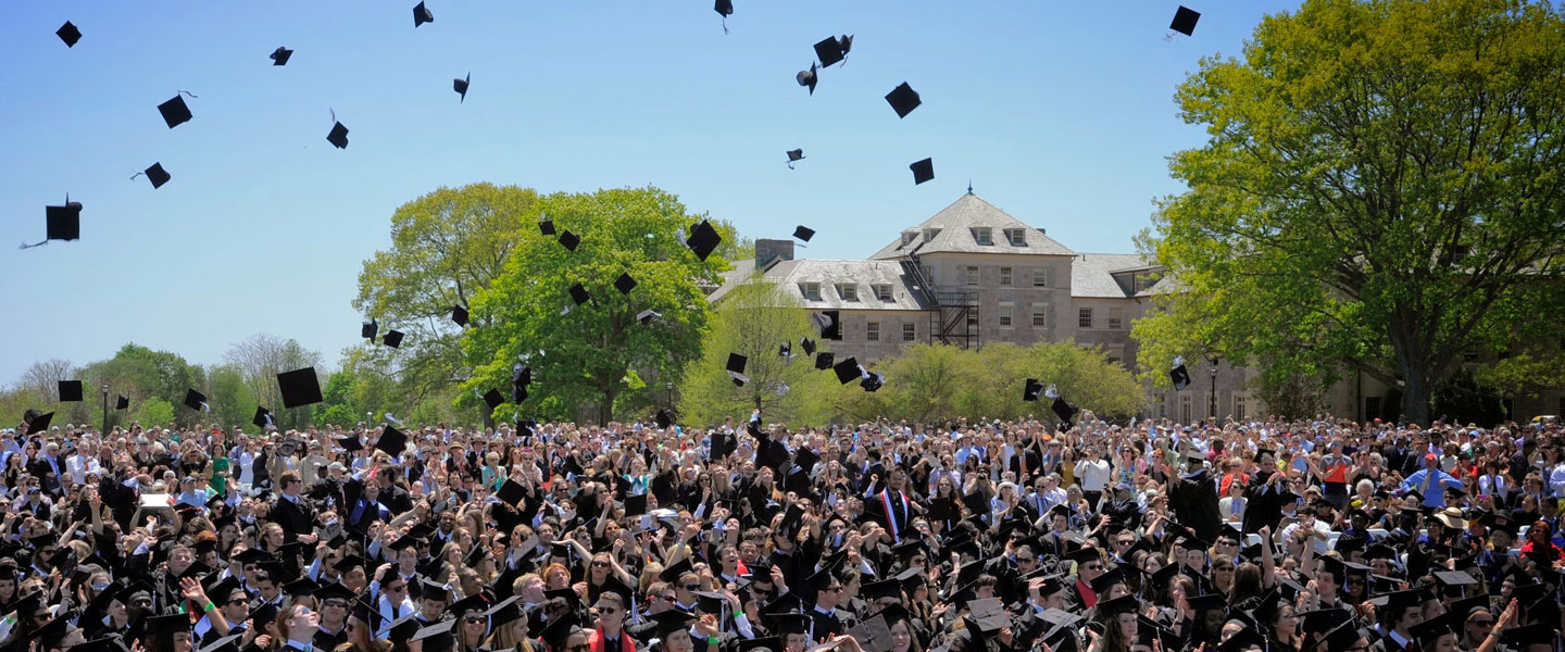 Graduates toss their caps at Commencement.