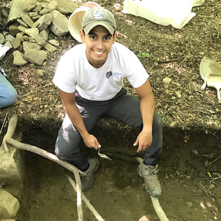 Hector Salazar conducts archaeological research at a dig site.