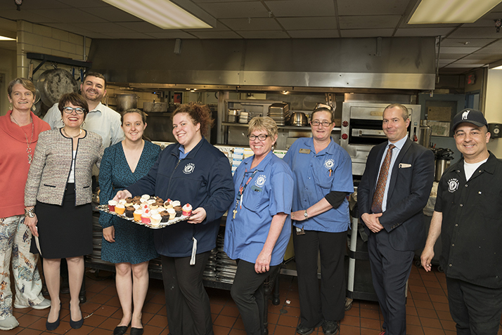 Members of the Catering Team pose for a photo with President Katherine Bergeron and others.