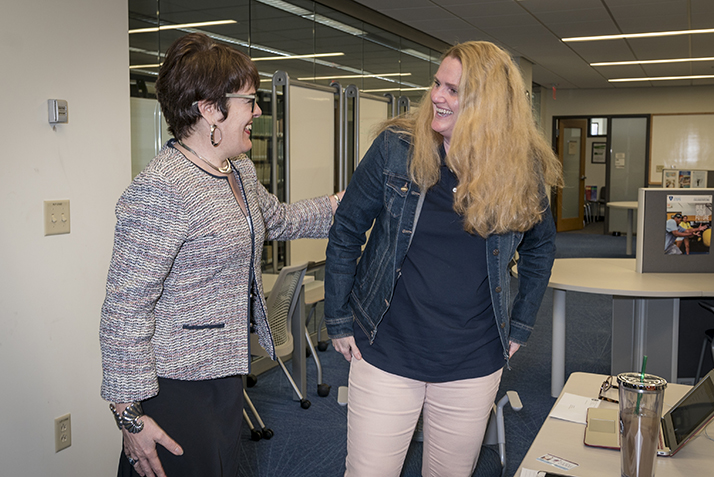 President Katherine Bergeron surprises Patricia Dallas, assistant director of the Academic Resource Center, with the Citizenship Award.