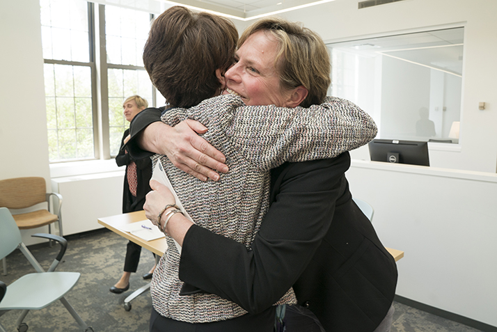 Melissa Ryan, assistant director of the Walter Commons, hugs President Katherine Bergeron after she is surprised with the Rising Star Award.