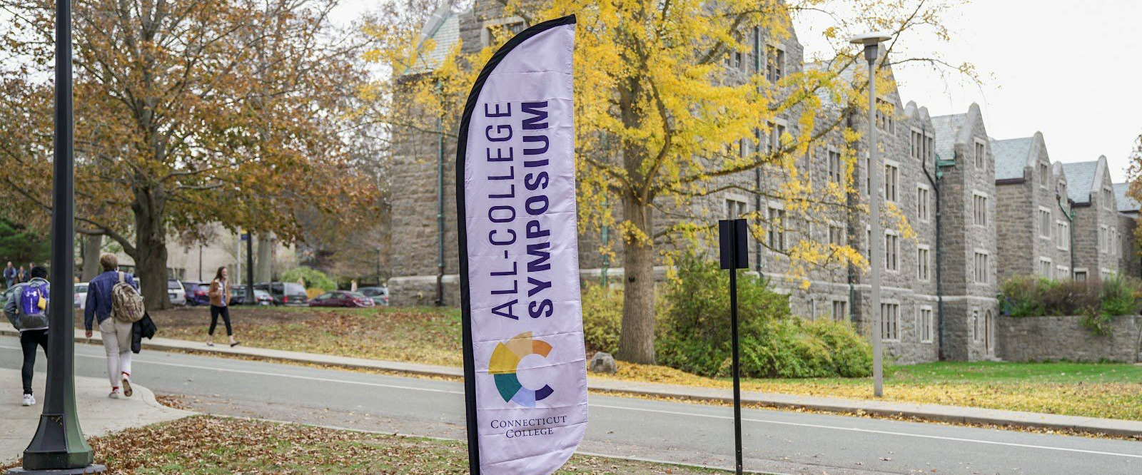 An All College Symposium banner on campus