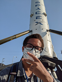 Cameron Aaron '21 poses in front of SpaceX