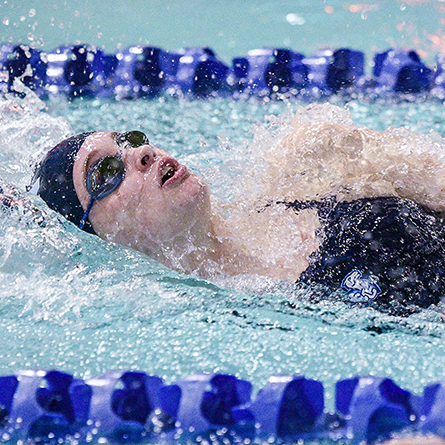 Tiernan Shea '23 competes in the backstroke.