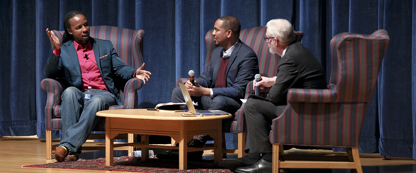 Ibram X. Kendi, DIEI John McKnight and USCGA Chief Diversity Officer Aram deKoven onstage during the Q and A portion of the event.