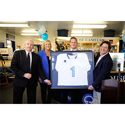 In addition to having the lacrosse locker rooms named in their honor, Karen and Rob Hale '88 (center) received a varsity lacrosse jersey from Fran Shields (left), the Katherine Wenk Christoffers '45 Director of Athletics, and Dave Cornell, head coach of the men's lacrosse team.