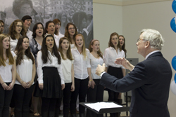 Retiring Professor of Music Paul Althouse leads the Connecticut College Chamber Choir in the singing of the College's Centennial Song at Founders Day in 2011.