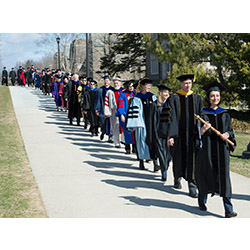 Delegates, wearing the colorful regalia of their institutions, take part in the processional leading Bergeron to Palmer Auditorium for the Inauguration.
