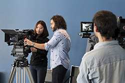 Sean Fine '96 (center) shows Bae Yung Kim '16 how to use an Arri Alexa camera while Juan Pablo Pacheco '14 films the two with a RED Epic.