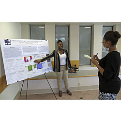 Amanda Crawford '14 presents her summer research at a recent poster session on campus.