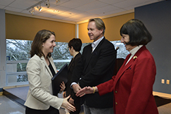 Martina Rudolf '14 (far left) is congratulated by Diane Y. Williams '59 and Jim Berrien '74 at a reception following the weeklong workshop.