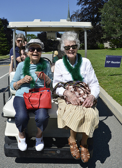 Alicia Speaker '43, left, and Barbara Brewster '43 catch a ride during Reunion 2013.