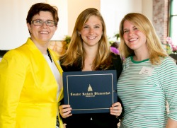 Alia Roth '14, center, poses with Laura Cordes, executive director of CONNSACS, left, and Darcie Folsom, Connecticut College's coordinator of sexual violence education and advocacy, right, after being honored with the Gail Burns-Smith award at a recent ceremony.