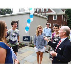President Higdon, right, speaks to students and faculty at the reopening of the College's historic Steel House, home to the new Office of Sustainability.