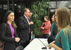 "Caitlyn Turgeon '08 (left), human capital consultant at Deloitte Federal Consulting, spoke with students after a panel discussion during the recent ""Sundays with Alumni"" program on careers in national security."