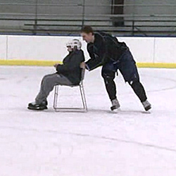 Senior Keith Veronesi takes 10-year-old John-Anthony Washburne skating on the Connecticut College ice.