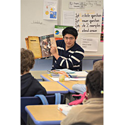 Pablo Tutillo '13 reads to fourth graders at New London's Winthrop Magnet Elementary School.