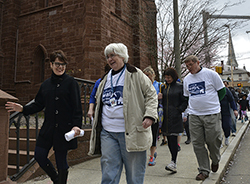 President Katherine Bergeron talks with New London Homeless Hospitality Center Executive Director Catherine Zall during the seventh annual Walk for the Homeless. For more photos from the walk, see the slideshow below.