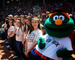 Members of The Shwiffs pose with Wally, the Boston Red Sox mascot, after singing the national anthem at the April 19 game.