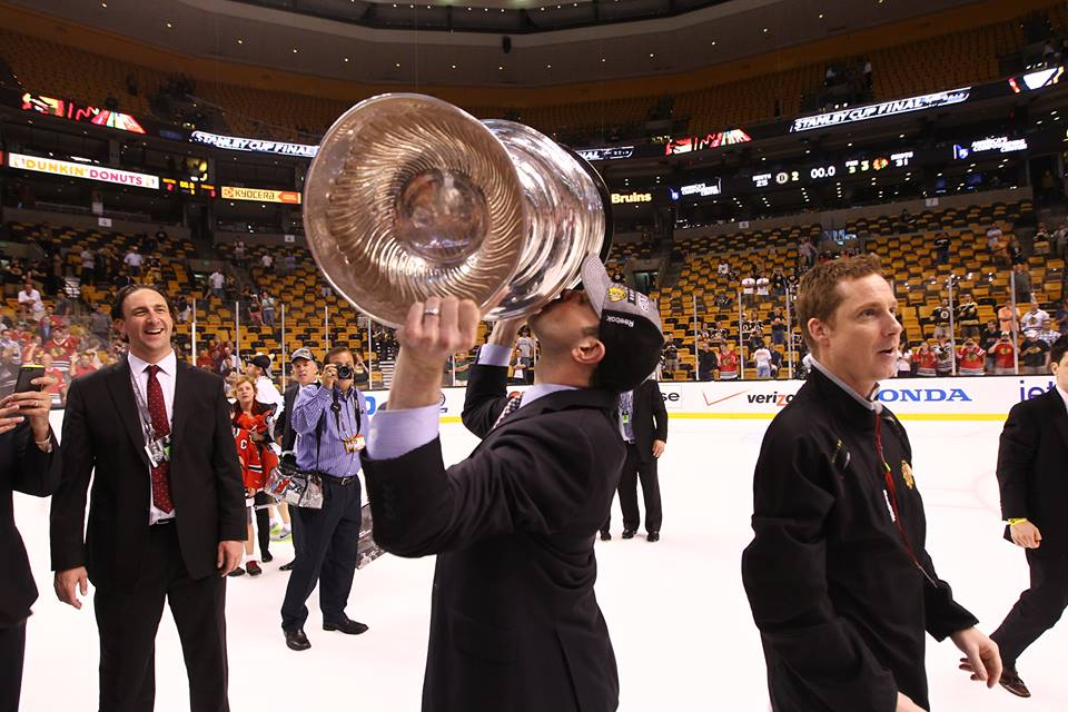 Adam Rogowin '03, director of media relations for the NHL's Chicago Blackhawks, sealed the team's Stanley Cup victory with a kiss.