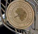 The Connecticut College seal on the mace