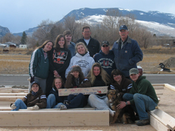This year's largest alternative spring break trip gives students the opportunity to travel to other states to help build homes for low-income families through Habitat for Humanity. Above, participants pose at the site of a Habitat home in Cody, Wyo.