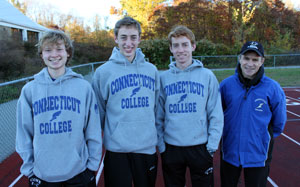 Co-captain Shawn Mulcahy '11, Mike LeDuc '14, Co-Captain Doug Wright '12 and Head Coach Jim Butler
