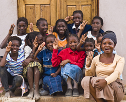 Children pose outside of the Chikumbuso school.