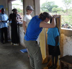 Brigid O'Gorman '11 records a child's height at the Asayo's Wish Orphanage in Kaberamaido, Uganda, in 2009.