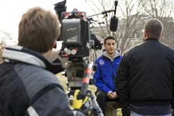 "Brenner Green ´12 is interviewed for the documentary film, ""Out for the Long Run"""