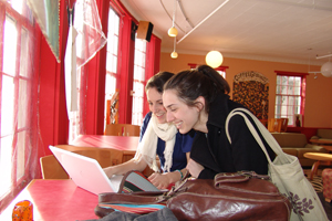 Alexandra Foley '12 (left) and Rebecca Lieberman '12 enjoy some downtime at Coffee Grounds.