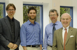 Professors Timo Ovaska, Simon Feldman and Robert Askins pose with President Leo I. Higdon Jr.