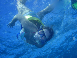 Rita Holak '10 snorkels on the Great Barrier Reef of the coast of Cairns.
