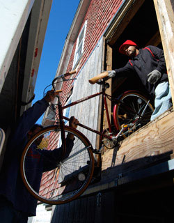 Donated bicycles are unloaded at Connecticut College.